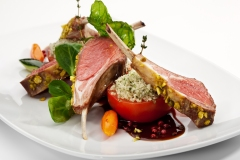 Roasted Lamb Chops with Pistachio. Garnished with Vegetables and Basil